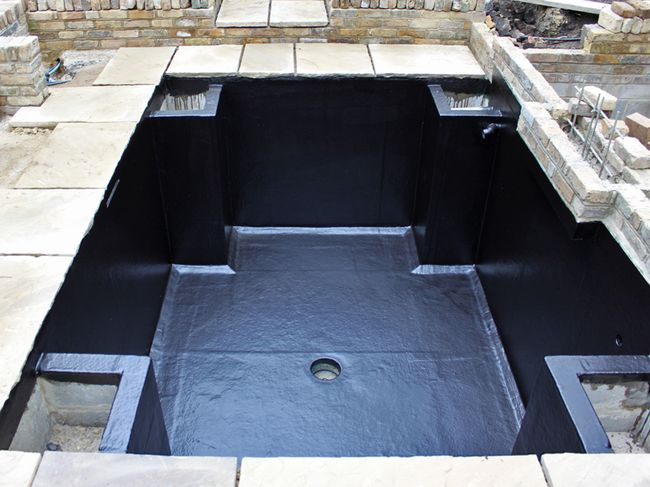 A koi pond water garden design build in pictures the for Koi pond design and construction