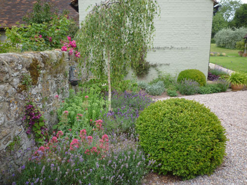 farm courtyard garden planting in drifts for a natural planting style