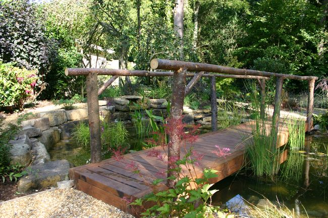 garden pond and bridge both built by Claudia de Yong Designs