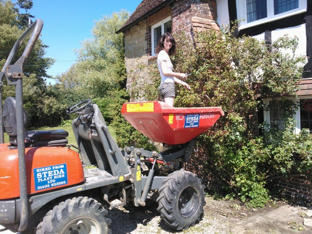 Claudia de Yong on a mini digger