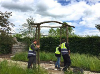 Lifting-the-handmade-pergola-into-position-450wide